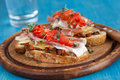 Delicious Bruchetta with ham and tomato Royalty Free Stock Photography