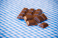 Delicious chocolate on a blue and white tablecloth Royalty Free Stock Photo