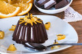 Delicious chocolate dessert with orange slices on sunrise light Royalty Free Stock Photo