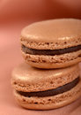 Delicious chocolate macaron cookies two stacked together with a shallow depth of field Stock Image