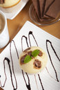 Delicious chocolate muffin on a decorated plate Royalty Free Stock Photography