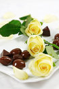 Delicious chocolate pralines with rose Royalty Free Stock Photography