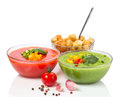 Delicious cold red and green gazpacho soup with garlic croutons in bowls Stock Photography