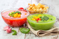 Delicious cold red and green gazpacho soup with garlic croutons in bowls Royalty Free Stock Images