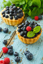 Delicious cupcake with fresh blueberry and raspberry Royalty Free Stock Photo