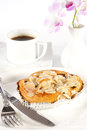 Delicious danish pastry with a cup of black coffee on white background Royalty Free Stock Photo