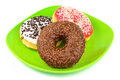 Delicious donuts green plate Stock Photos