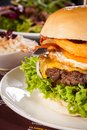 Delicious egg and bacon cheeseburger with a nutritional filling of salad ingredients a ground beef patty cheese fried Stock Photos