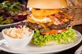 Delicious egg and bacon cheeseburger with a nutritional filling of salad ingredients a ground beef patty cheese fried Stock Photo