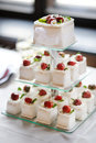 Delicious fancy wedding cake made of cupcakes strawberry Royalty Free Stock Photography