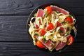 Delicious fettuccine pasta with tuna steak, tomatoes and capers Royalty Free Stock Photo