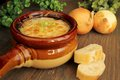 Delicious french onion french soup in a ceramic bowl Royalty Free Stock Photo