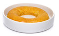 Delicious french ring cake named savarin on white Stock Image