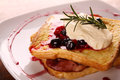 Delicious french toast with bacon syrup berries and cream on a white plate on a wooden table Stock Images
