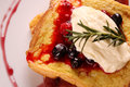 Delicious french toast with bacon syrup berries and cream on a white plate on a wooden table Royalty Free Stock Photo
