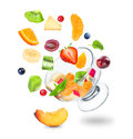 Delicious fresh fruit salad falling Royalty Free Stock Photo