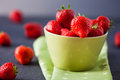 Delicious fresh strawberries in a green bowl Royalty Free Stock Photo