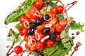 Delicious fresh tomatoe salad and olive oil Stock Images