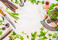 Delicious fresh vegetables spices and seasoning for tasty cooking with kitchen knife on white wooden background top view frame Royalty Free Stock Photo