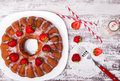 Delicious glazed cake with strawberries on white wooden table Royalty Free Stock Photo