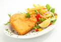 Delicious golden heart shape veal escalope covered in fried breadcrumbs and served with a healthy fresh mixed salad and crisp Royalty Free Stock Photography