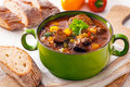 Delicious goulash casserole in a metal pot with thick rich gravy meat and vegetables for a wholesome meal Stock Image