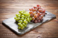 Delicious grapes on a kitchen table Royalty Free Stock Photo