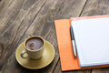 Delicious greek coffee perfect and notebook on wooden table Stock Images