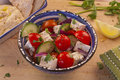 Delicious greek salad bowl of with humus and pitta bread Stock Image