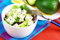 Delicious greek salad still life with avocado and feta Royalty Free Stock Photo