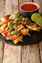 Delicious grilled chicken skewers with vegetables served with ke Royalty Free Stock Photo