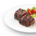Delicious grilled tenderloin steak served with mashroom sauce and vegetables on white Stock Image