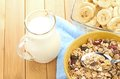 Delicious and healthy cereal in bowl with milk bananas on table room Royalty Free Stock Image