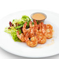 Delicious healthy cooked royal shrimps served with ruccola salad and sauce on white Royalty Free Stock Photography