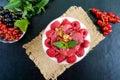 Delicious healthy dessert: yoghurt, fresh berries, granola, raspberry sauce Royalty Free Stock Photo