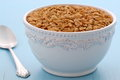 Delicious and healthy granola cereal nutritious lightly toasted breakfast muesli or on vintage styling Stock Photo