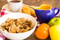 Delicious and healthy granola with dry fruits nuts and milk bowl of Stock Images