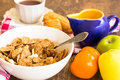 Delicious and healthy granola with dry fruits nuts and milk bowl of Royalty Free Stock Image