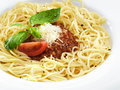 Delicious healthy spaghetti bolognese pasta with meat tomato sauce with basil leaf and parmesan on a round white plate isolated on Stock Photos