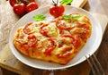 Delicious heart shaped Italian pizza Royalty Free Stock Photo