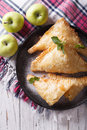 Delicious homemade apple pie turnover close up vertical top vie on a plate view Royalty Free Stock Image