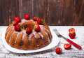 Delicious homemade cake with strawberry and glaze on wooden background Stock Images