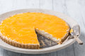 Delicious homemade cheese cake with fruit topping orange passion Stock Photography