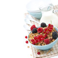 Delicious homemade granola with fresh berries and milk isolated on white Royalty Free Stock Photos
