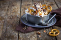 Delicious homemade ice cream with salted caramel and chocolate sauce nuts in vintage metal bowl selective focus Stock Images