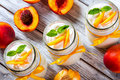 Delicious homemade yogurt with pieces of peach, top view Royalty Free Stock Photo
