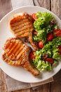 Delicious honey grilled chop pork served with a salad of fresh v Royalty Free Stock Photo