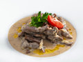 Delicious hot beef stroganoff with cream sauce served on a white plate isolated on white Stock Image