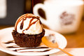 Delicious icecream on top of a brownie with a chocolate sauce in the plate Royalty Free Stock Photo