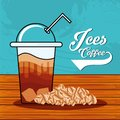 Delicious iced coffee with straw in wooden table